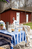 Blue and white tablecloth on table on terrace