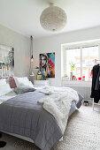 Blanket on bed in bright bedroom