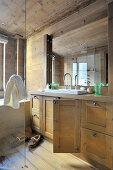 Washstand with open door in wooden bathroom