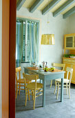 Blue and yellow dining room with simply set breakfast table