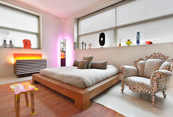 Horizontal windows with louvre blinds in artistic bedroom
