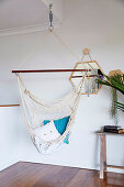Hammock in front of a wall mirror