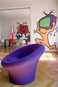 Round purple easy chair in front of pop-art murals on walls
