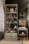 Various antique ornaments on vintage shelves