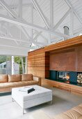 Living room in modern, architect-designed house with exposed roof structure