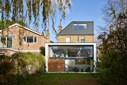Traditional brick house with modern extension and garden