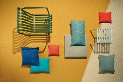 A garden chair and stool with decorative cushions made from UV and water-resistant fabrics