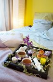 Gifts on breakfast tray on double bed