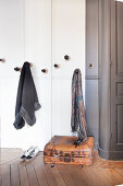 Coat pegs at various heights in cloakroom