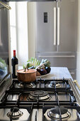 Copper saucepan on modern gas hob