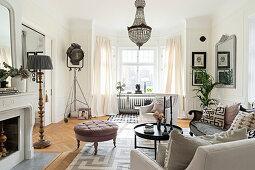 Vintage accessories in elegant living room in pastel shades