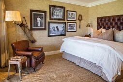 Antique sporting gear and vintage photos in elegant bedroom
