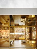 Luxury living area with open mirrored glass façade and veranda with mirrored ceiling