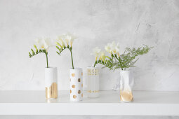 Gold and white vases hand-made from cans