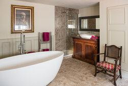 Modern, oval bathroom and antique furniture in bathroom