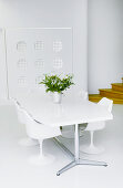 Designer furniture and wall decoration in white dining room