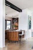 Elegant kitchen island with bar stools between the kitchen and living room