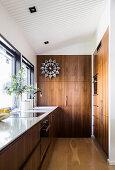 Elegant kitchen with walnut fittings