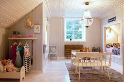Cubby bed under sloping ceiling in child's rustic bedroom
