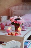 Coffee table romantically set with vase of roses and macarons