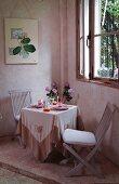 Romantically set table below window