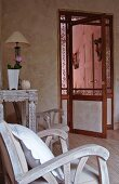 Shabby-chic wooden chairs in front of vintage-style glass door