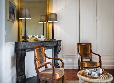 Two chairs in front of mantelpiece in Château des Grotteaux