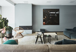 Modern fireplace in pale blue wall in living room