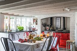 Red range cooker and festively decorated dining table