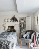 Furry Christmas stockings hung from fireplace in grey and white bedroom