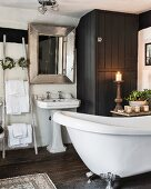 Free-standing bathtub and subtle festive decorations in bathroom