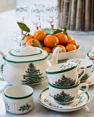 Tea service with Christmas-tree pattern and bowl of tangerines