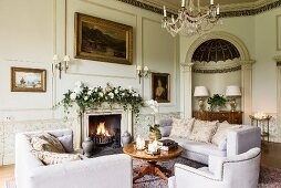 Stately drawing room with Christmas garland of ivy on mantelpiece