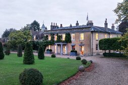 Old English manor house with drive and gardens