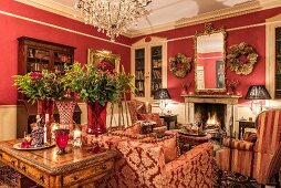 Open fireplace in classic living room in shades of red