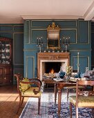Antique furniture in classic dining room with panelled walls