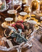 Christmas pomanders made from cloves and ribbons on coffee table