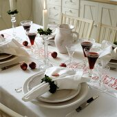 Wreaths of leaves as linen napkins on festively set table