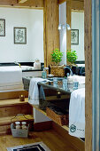 Twin, black marble washstand and wooden steps leading to bathtub in chalet bathroom