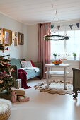 Wreath hanging over couch in festive living room