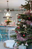 Christmas tree in country-house-style dining room