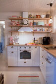 Wall-mounted shelves in romantic country-house kitchen