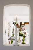 Lit candles and Christmas greetings in aperture in wall
