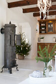 Cast-iron stove and Christmas decorations in country-house kitchen