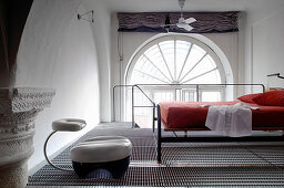 Bedroom on mezzanine with metal mesh floor