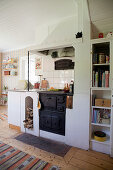 Old, wood-fired kitchen stove in Scandinavian country-house kitchen