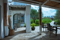 Table and chairs on terrace of Mediterranean house