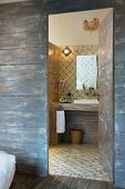 Mediterranean bathroom behind rustic board wall