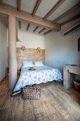 Rustic board floor and wall in bedroom