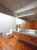 Concrete and wood bathroom in modern architect-designed house